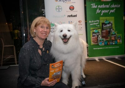 Jetpets Rescue Awards Ceremony 2019: Cathy Beer, Founder holding Loyalty Pet Treats with rescue dog, Yoshi. Jo Lyons Photography